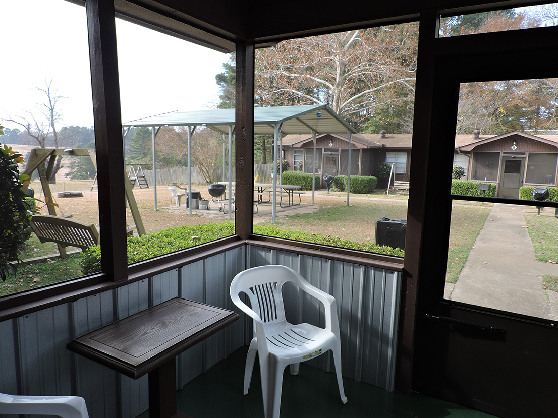 Screened porch with view of courtyard